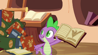 Spike showing the book to the ponies S3E05