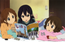 Ui, Azusa and Ui reading a London book.png