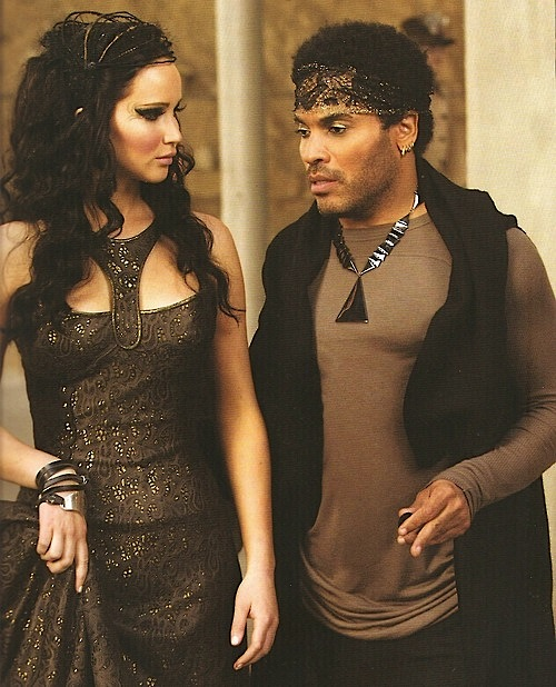 Cinna instructs Katniss on her tribute parade costume Catching Fire Tribute Costumes
