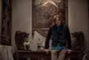 Lex Luthor leaning on a table - promotional still.jpg