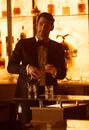 111 promo Lucifer pours drink.jpg